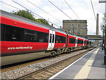 SE1338 : Leeds-bound train passing through Saltaire by Pauline E