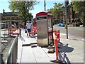 SJ9494 : Flags around the phone box by Gerald England