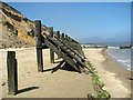 TG2938 : Derelict revetments and groynes by Evelyn Simak