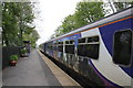 NY7764 : Carlisle to Newcastle train stops at Bardon Mill station by Roger Templeman