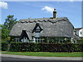 TL1466 : Thatched cottage, West Perry by JThomas