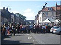 NT9953 : Crowds on Marygate - Olympic torch relay (1) by Graham Robson