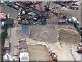 TQ3980 : Thames Wharf: aggregate stockpiles by Stephen Craven