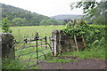NY5045 : Gateway and footpath stile south of the village by Roger Templeman