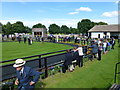 TL6161 : The July Course, Newmarket - Horses leaving the parade ring by Richard Humphrey