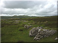 SD6678 : Limestone outcrops and heather moorland by Leck Fell Lane by Karl and Ali