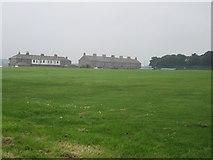 NU0052 : Terraced Houses beside Pier Field by Graham Robson
