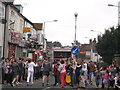TQ7767 : Olympic Torch Runner and crowds on Canterbury Street, Gillingham by David Anstiss