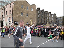 TQ7568 : Olympic Torch Relay Runner, Medway Road, Chatham by David Anstiss