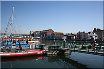 SY6778 : North Quay moorings. by John Stephen