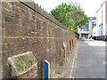 TQ3180 : Eastern boundary wall to St John's church by Stephen Craven