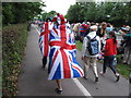TQ1568 : Flag-bedecked spectators at Olympics cycling time trial by David Hawgood