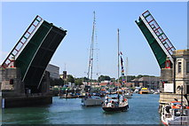 SY6778 : Yachts passing through Weymouth's Town Bridge by Roger Davies