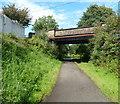 ST2998 : Road bridge over footpath near Sebastopol by Jaggery
