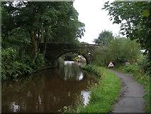SD9726 : Rochdale Canal bridge 21 by John Slater