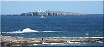 NU2135 : Telephoto of Inner Farne island and lighthouse by Mike at Seahouses