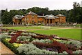 SP6865 : Looking over a flower border to the Stables by Steve Daniels