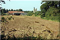 TF9227 : Pudding Norton church and farm by Peter Turner