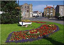 SD4161 : Floral display, Heysham village by Ian Taylor