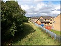 NS8256 : Houses backing onto the disused rail track at Newmains by Elliott Simpson