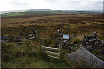SD7221 : Fences and stile on Grey Stone Hill by Bill Boaden