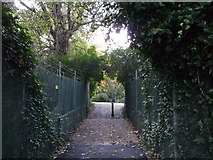TQ7668 : Bridge over Chatham Lines leading to Officers Tennis Club, Brompton by David Anstiss