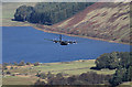 NT2319 : A Hercules flying low over Loch of the Lowes by Walter Baxter