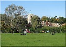 TL3949 : Barrington: playground and All Saints' tower by John Sutton