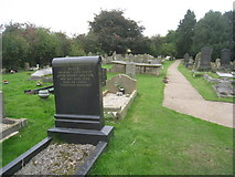 SE8317 : St. Oswald's churchyard, Luddington by Jonathan Thacker