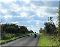 SU0046 : 2012 : Motorcyclist on the minor road from Chitterne by Maurice Pullin