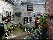 SK2354 : Bricabrac in The Miners Arms backyard by Graham Hogg
