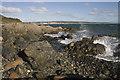 SW4727 : Rocky shore at Roskilly by Elizabeth Scott