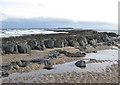 NU1934 : Rocky outcrop, Bamburgh beach by Pauline E