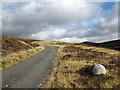 NN5467 : Estate road in upper valley of Allt Ghlas by Trevor Littlewood