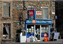 J1586 : Shop and petrol pumps, Antrim by Albert Bridge