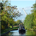 SJ5948 : Narrowboat and Wrenbury Church Lift Bridge, Cheshire by Roger  Kidd