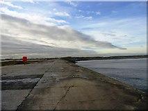 NZ5428 : View down the breakwater by Robert Graham