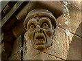 NS3979 : Smollett Mausoleum: carved head by Lairich Rig