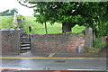 NY0437 : The steps of Pigeonwell Lonning at A596 entrance by Roger Templeman