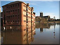 SO8454 : Former warehouse and Worcester Cathedral reflected in floodwater by Philip Halling