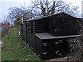 TL8607 : Canalside Hut by Roger Jones