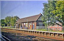 TQ0562 : Byfleet & New Haw station, Up Slow line platform by Ben Brooksbank