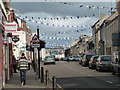 NS7809 : Sanquhar: bunting in the High Street by Chris Downer
