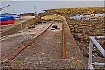 J5182 : Small pier with rails near Seacliff Road, Ballyholme, Bangor by P L Chadwick