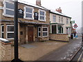 SP9677 : Empty pub and Fish & Chip shop in Woodford by Michael Trolove