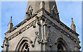 TF0543 : Tower carvings, St Denis' church, Silk Willoughby by J.Hannan-Briggs