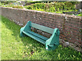 SX9272 : Green seat against the wall to the allotments by Robin Stott
