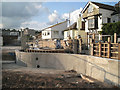 SX9372 : Curved flood wall under construction by Gales Hill by Robin Stott