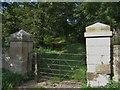NT8843 : Gateway to footpath to Twizel Castle by Barbara Carr