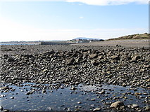 J3213 : The stony beach east of the entrance to Kilkeel Harbour by Eric Jones